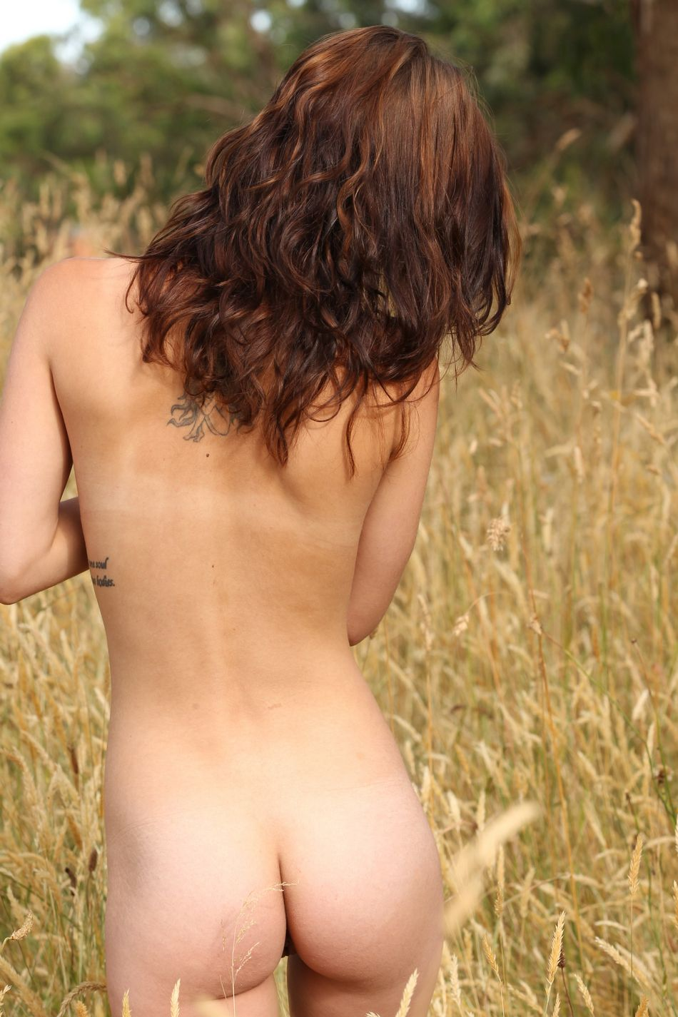 come and take a roll in the long grass totally naked as she fucks herself with a large sex toy-4