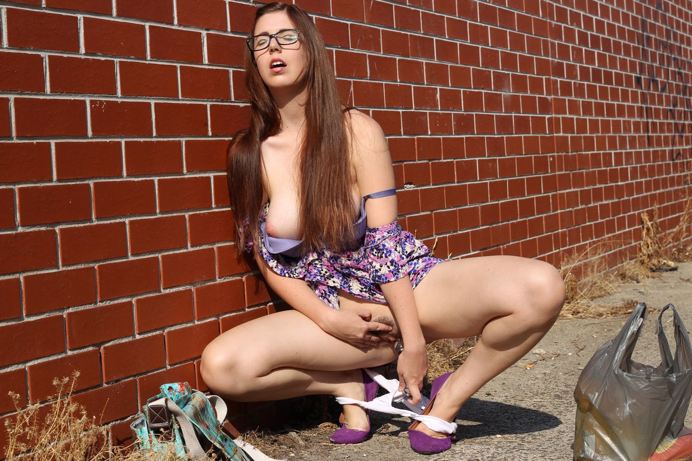 nerdy amateur viola wearing her glasses as she finds a random spot to play with a sex toy in the street-4